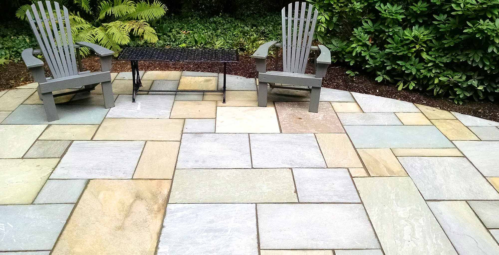Irondequoit Landscape - Hardscaping, Installation of pavers, brick, flagstone, patios, retaining walls, natural stone walls, steps, and front stoops in Rochester, NY.