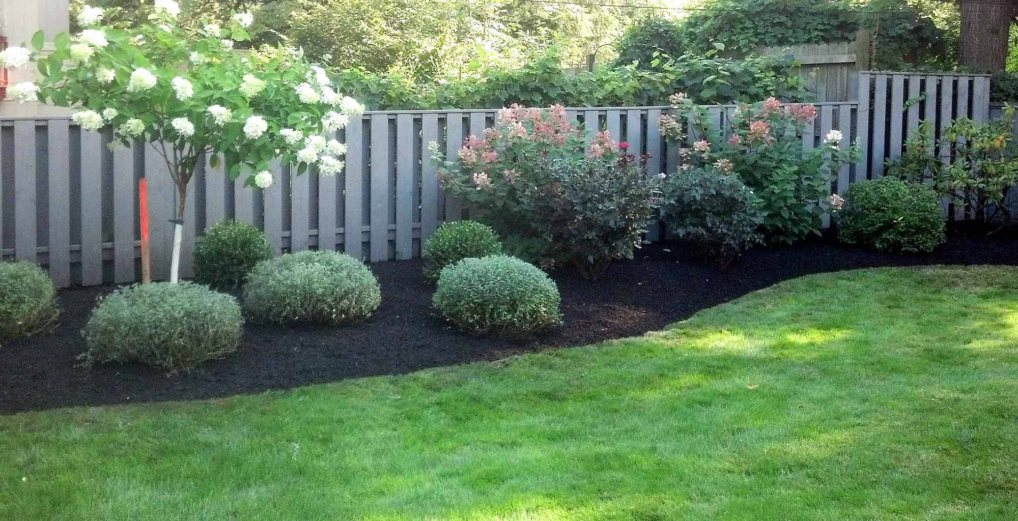 Irondequoit Landscape - Lawn Care & Maintenance, Spring/Fall clean-ups, mowing, shrub & tree pruning, mulching, weeding & bed edging, lawn re-seeding, lawn core aeration, lawn de-thatching in Rochester, NY.